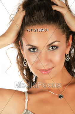 Close-up Portrait Of Beautiful Caucasian Model Wearing Earrings And Necklace On White Stock Photo
