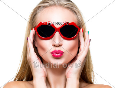 Close-up Portrait Of Beautiful Young Girl With Red Lips Wearing Lips-shaped Sunglasses Stock Photo