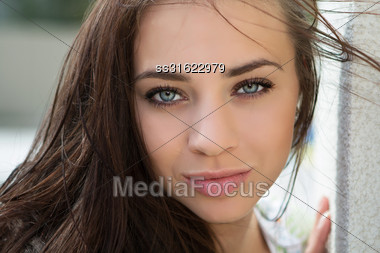 Close-up Of Pretty Flirtatious Woman Posing Near The Wall Stock Photo