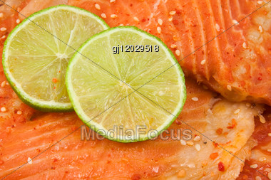 Close Up Of Salmon With Green Lemon. Stock Photo