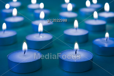 Close Up View Of The Candles Cutting Through The Darkness Stock Photo