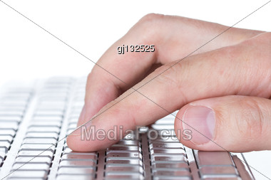 Close-up View Of Hand Typing On A Computer Keyboard Stock Photo