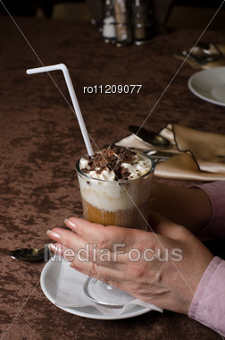 Closeup Of Female Hands Holding Cup Of Latte Stock Photo