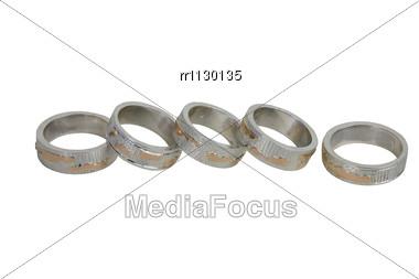 Closeup Of Five Handiwork Rings Stock Photo
