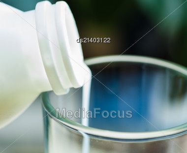 Closeup Image Of A Milk Poured In Glass Cup Over Indoors Background Stock Photo