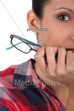 Closeup Of A Woman With Glasses Stock Photo