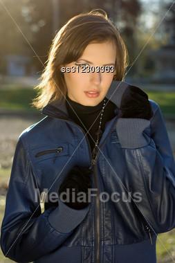 CLoseup Portrait Of A Girl In Autumn Park Stock Photo