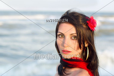 Closeup Portrait Of Nice Young Brunette On The Beach Stock Photo