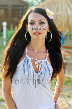 Closeup Portrait Of A Nice Young Brunette Outdoors Stock Photo