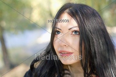 Closeup Portrait Of A Nice Young Woman In Autumn Park Stock Photo
