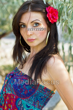Closeup Portrait Of A Pretty Young Brunette Outdoors Stock Photo