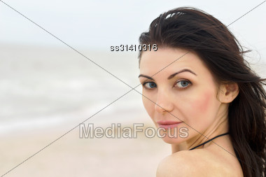 Closeup Portrait Of A Pretty Young Woman On The Beach Stock Photo