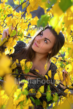 Closeup Portrait Of A Pretty Young Woman Outdoors Stock Photo