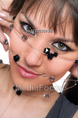 Closeup Portrait Of Young Brunette With A Bead. Stock Photo