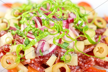 Closeup Of Salad From Salami, Vegetables And Olives Stock Photo
