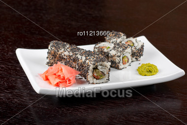 Closeup Of Sushi Rolls At Plate With Sesame Stock Photo