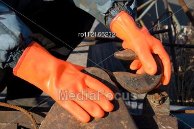 Closeup Of Worker Man At Orange Gloves Stock Photo