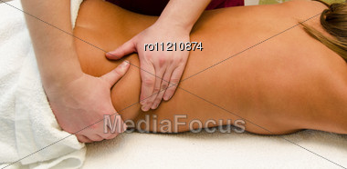 Closeup Of Young Woman Getting A Back Massage Stock Photo