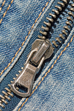 Closeup Of The Zipper Of A Stylish Blue Jeans Stock Photo