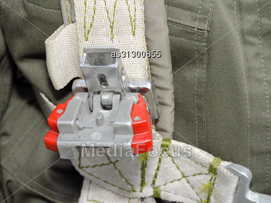 Clothing, Harness Military Pilot In A Green Jumpsuit. Stock Photo