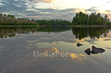 Clouds Reflected On A Lake In The Boundary Waters Canoe Area Wildernes In Minnesota Stock Photo