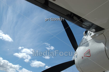 Cloudy Sky And Wing Of Dornier 228 Aircraft Stock Photo