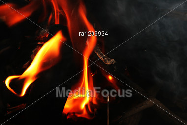 Coal And Fire In Fireplace. Stock Photo