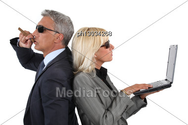Cocky Businessman And Businesswoman Stock Photo