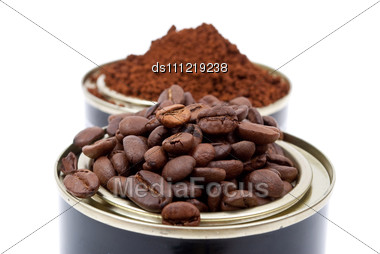 Coffee Beans In Tin Cans Stock Photo