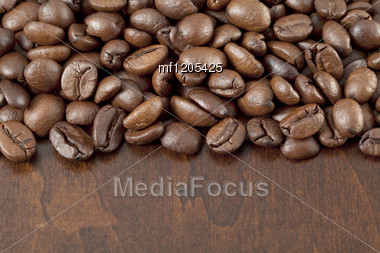 Coffee Beans On The Wooden Background Stock Photo