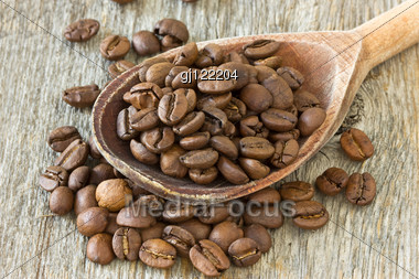 Coffee Beans With Wooden Spoon On Wood Background Stock Photo