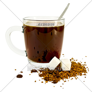 Coffee In A Glass Mug, A Spoon, Grains And Granules Of Coffee On A Table With Two Lumps Of Sugar Stock Photo