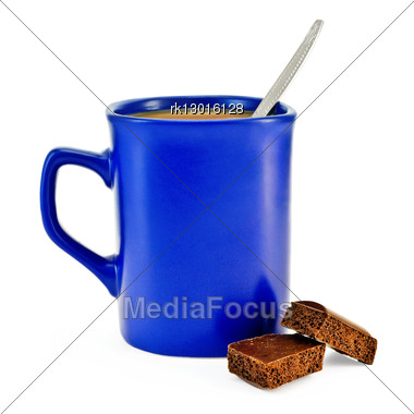 Coffee With Milk, A Silver Spoon In A Blue Mug, Two Slices Of Porous Brown Chocolate Stock Photo