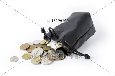 Coins Falling From String Purse Stock Photo
