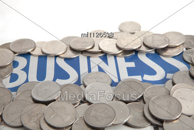 Coins On The Business Newspaper Stock Photo