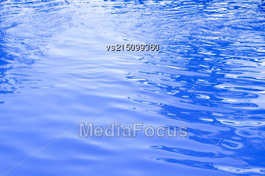 Cold Blue Water At Sun Light. Water Background Stock Photo