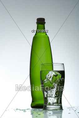 Cold Purified Water In The Glass With Bubbles And Reflection Stock Photo