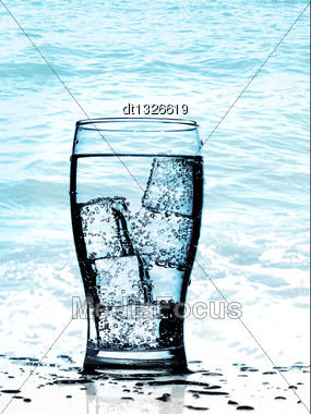 Cold Purified Water In The Glass With Bubbles And Reflection On The Wet Background Stock Photo
