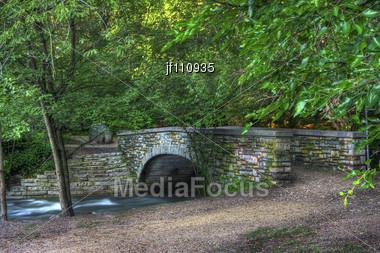 Colorful Brick River Bridge In High Dynamic Range Stock Photo