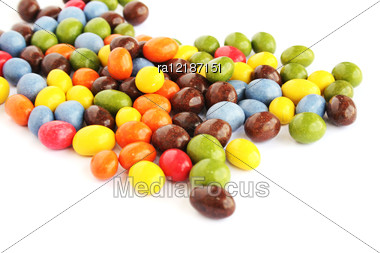 Colorful Candies With Raisins And Peanuts Isolated On White Background. Stock Photo