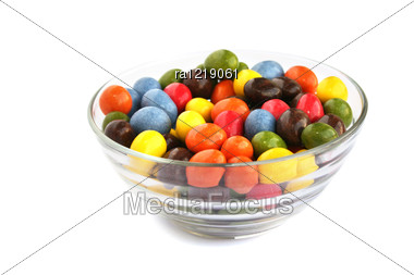 Colorful Candies With Raisins And Peanuts In Vase Isolated On White Background. Stock Photo