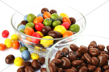 Colorful Candies With Raisins And Peanuts In Vases Isolated On White Background. Stock Photo