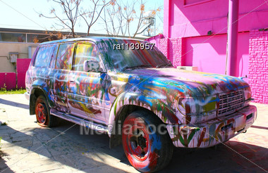 Colorful Car At Pink Wall. Stock Photo