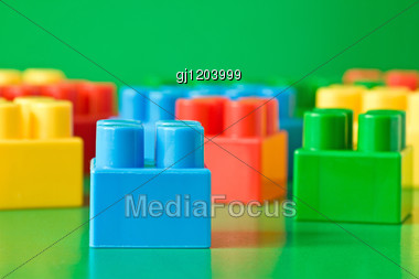 Colorful Childish Blocks On Green Background Stock Photo