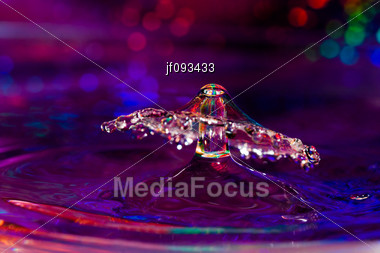 Colorful Design Of A Water Drop Collision Stock Photo