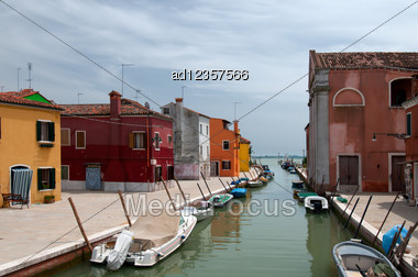 Colorful Houses And Canals Of Burano Island, Italy Stock Photo