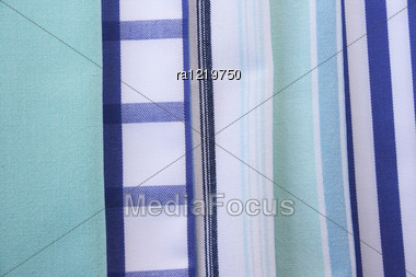 Colorful Kitchen Towels As A Background. Stock Photo