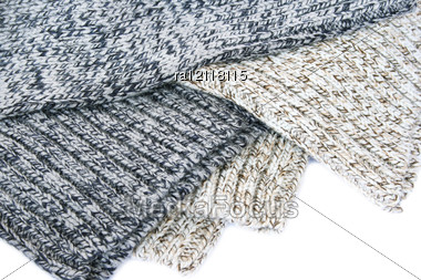 Colorful Knitted Cloth On White Background. Stock Photo