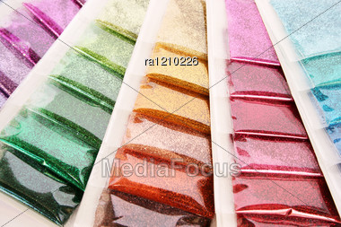 Colorful Nail Glitters As A Background. Stock Photo