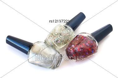 Colorful Nail Polishes Isolated On White Background. Stock Photo